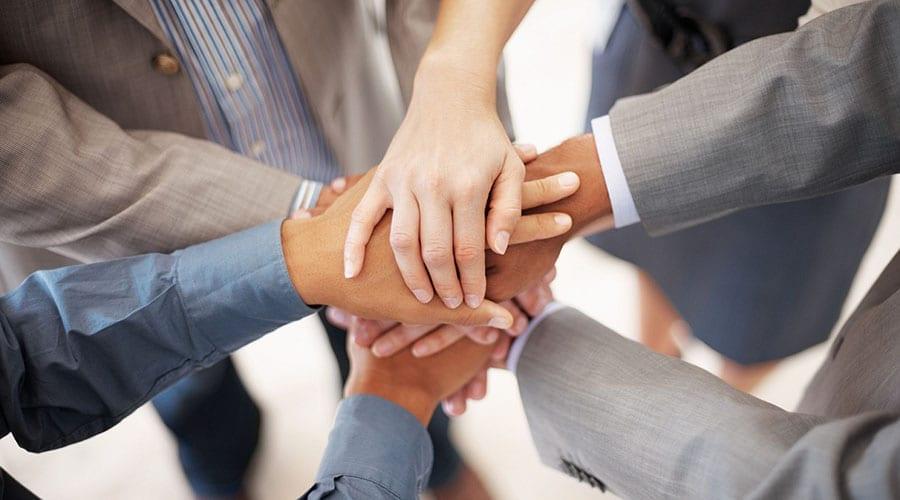 Como funciona o consórcio de empresas e quais são as suas vantagens?
