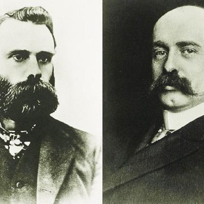 Charles Dow and Edward Jones, cofounded the Dow Jones & Company in 1882, a Wall Street financial news service, that became THE WALL STREET JOURNAL in 1889. Photos. Ca. 1900.